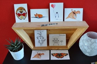 A6 postcards with illustrations and a white background